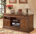"Ashley Hamlyn H527-46 60"" Large Credenza Including 2 Drawers and 5 Shelves with Simple Pulls  Decorative Hardware and Bottom Shelf in Medium Brown"