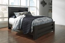 Ashley Brinxton Collection B249-67-64-98 Queen Size Panel Bed with Clean Line Design  Horizontal Pocket Details  Block Feet and Replicated Oak Grain in Black